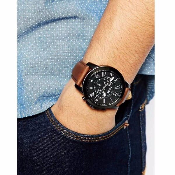 Fossil FS5241 being worn by man  wearing blue jeans