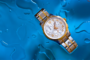 Are Watches Water Proof. Watch displayed in puddle of water.