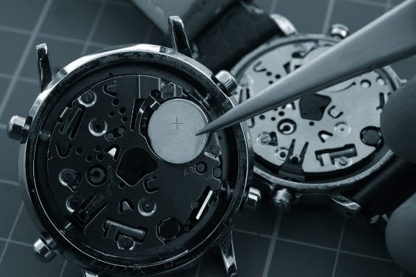 If the watch has a battery, it is NOT an automatic watch . You don't have to replace the battery on an automatic watch.
