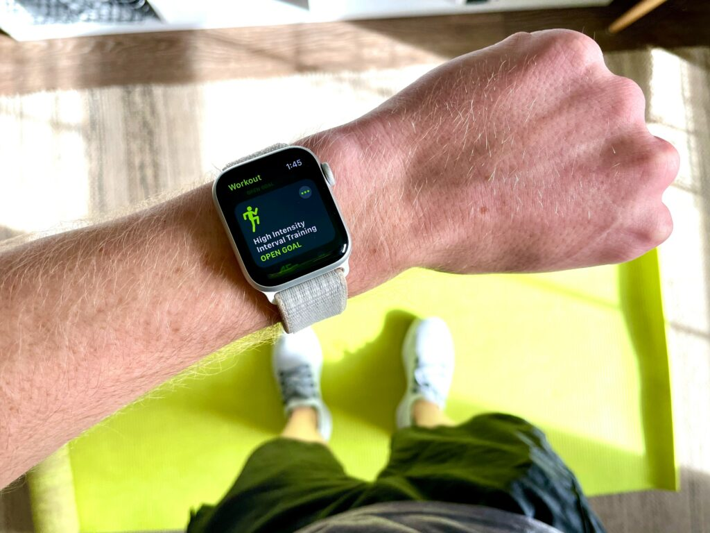 Person looking at Apple Watch on wrist. Where to wear Apple watch on wrist?  The key is to make sure that it makes good skin contact.