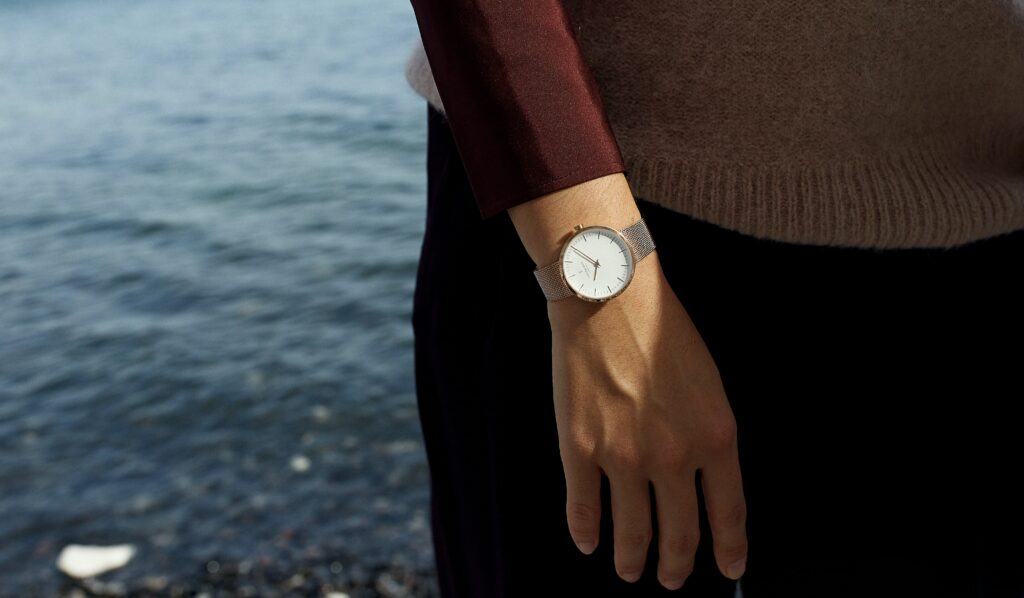 What side do women wear watches? woman standing near water with watch on right wrist