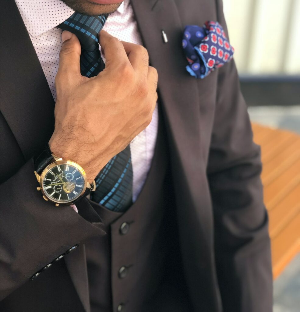 man wearing three piece suit with watch on right hand. Is there psychology to wearing watch in right hand?  Maybe.