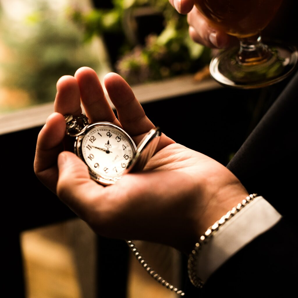 Silver pocket watch in hand.  Tissot Swiss made watches are both beautiful and functional