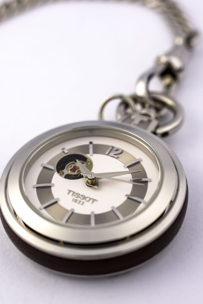 Silver pocket watch isolated on white.  Tissot watches have a reserve power