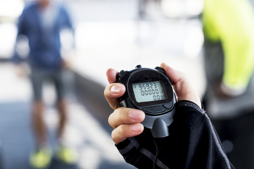 Stopwatch in woman's hand.  Full featured stop watches are not only accurate but have plenty of features, like storing multiple lap times.
