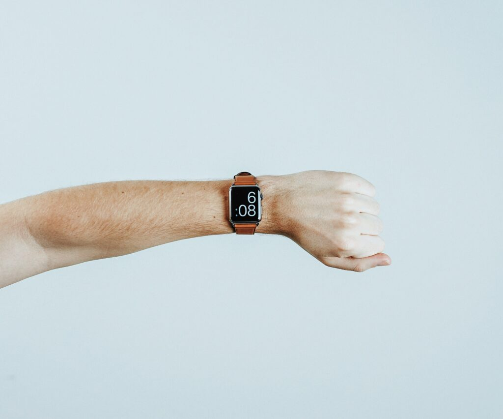 person looking at apple watch on left wrist
