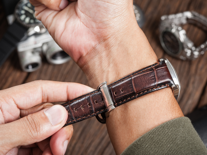 Tightening brown leather watchband. How Tight Should A Watch Be? How Loose Should a Watch Be?